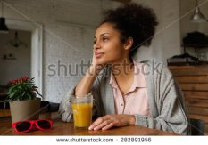 stock-photo-portrait-of-a-beautiful-african-american-woman-sitting-at-home-thinking-282891956