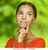 stock-photo-portrait-of-dark-haired-pensive-beautiful-young-woman-in-red-blouse-against-green-of-summer-park-120588886
