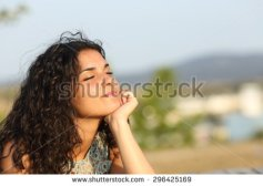 stock-photo-woman-relaxing-and-enjoying-the-sun-in-a-warmth-park-at-sunset-296425169