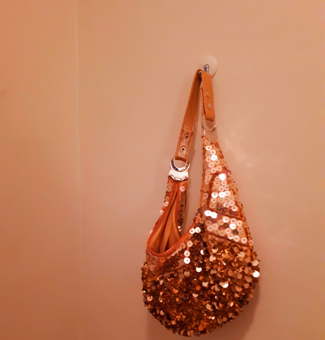 sequined bag hanging on wall